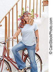 Young women with bycicle stays near  stairs