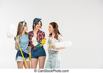 Young women with cleaning supplies - Three beautiful young...