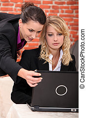 Young women working at a laptop