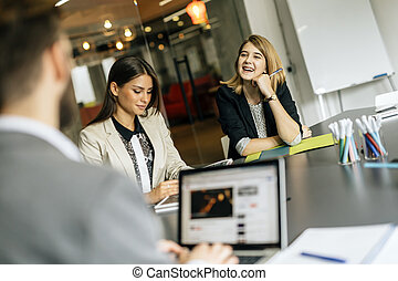 Young women working in office