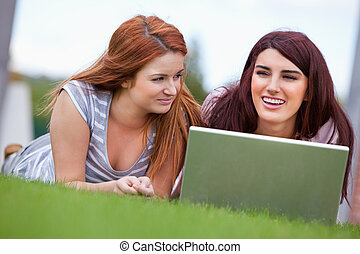 Young women working with a notebook