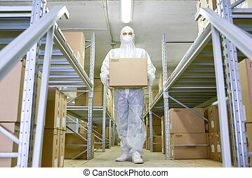Young Worker Carrying Cardboard Box