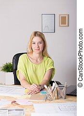 Young worker of creative company