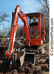 Young worker sitting in an excavator