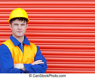 Young worker wearing a hardhat - Portrait of a young worker ...