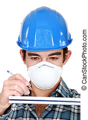 Young worker wearing protective face mask