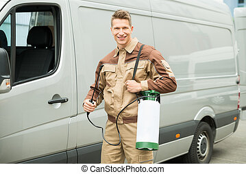 Young Worker With Pesticide In Front Van - Young Male Worker...