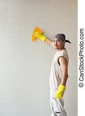 Young worker with spatula