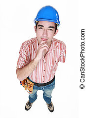 Young workman standing on white background