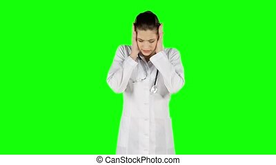 Young worried doctor holding his head. Green screen