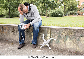 Worried Man With Broken Drone