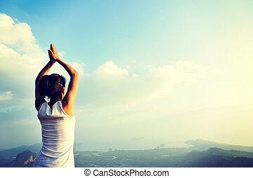 young yoga woman mountain peak