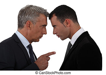 Younger and older businessmen head to head