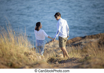younger couples relaxing happiness emotion at vacation seaside