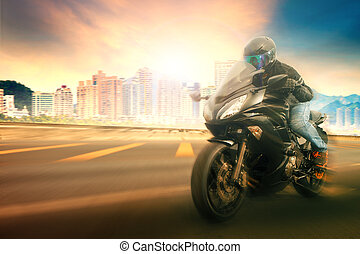 younger man wearing safety helmet and riding suit  biking sport motorcycle on urban road