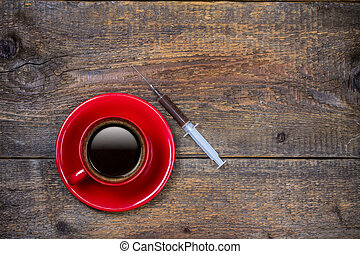 Your daily shot of coffee with cup and syringe
