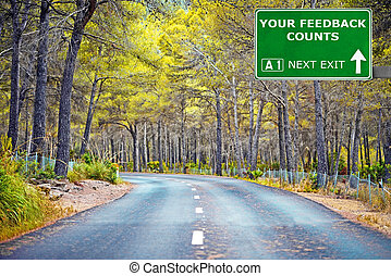 YOUR FEEDBACK COUNTS road sign against clear blue sky