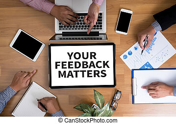 YOUR FEEDBACK MATTERS Business team hands at work with...