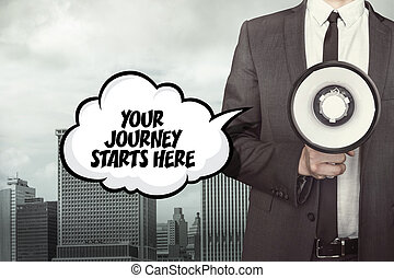 Your journey starts here text on speech bubble with businessman and megaphone