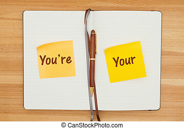 You're and Your on two sticky notes in a journal with a pen