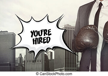 Youre hired text on speech bubble with businessman...