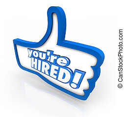 You're Hired words in 3d letters on a thumbs up symbol to illustrate the best or top job candidate being hired for an open position