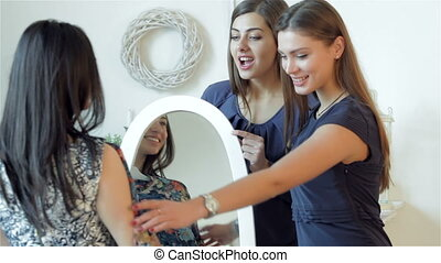You're is irresistible girl. Girlfriends at the mirror...