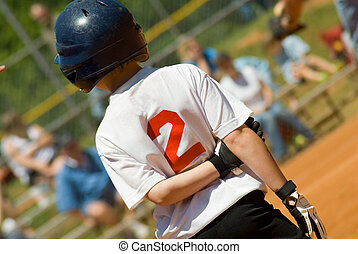 Youth Baseball Player - A young batter who made it to base...