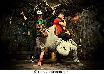 youth culture - Modern dancers dancing in the garage. Urban...