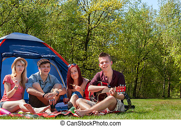 Youth on a camping having a great time - Young teenager...