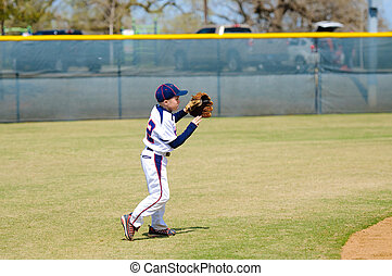 Youth shortstop about to throw ball - Youth baseball ...