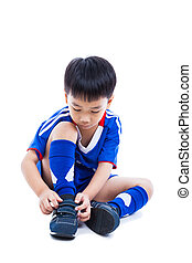 Youth soccer player tying shoe and prepare for competition. Sport lifestyle. Isolated on white