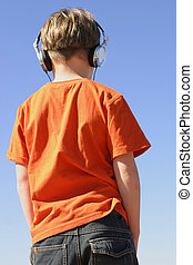 Youth with headphones - Young boy in jeans and t-shrit ...