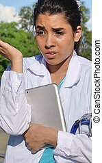 Youthful Colombian Female Nurse Thinking