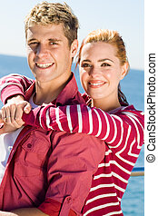 youthful couple - a happy couple posing and smiling