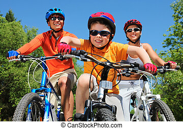 Youthful cyclist - Portrait of happy boy riding bicycle in...