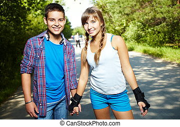 Youthful dates - Couple of happy teens looking at camera ...