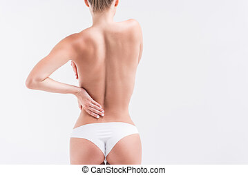 454d24b9370 Youthful fit girl in underclothes covering bust. Close up of hips and body  of young slim ...