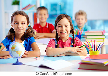 Youthful learners - Portrait of two diligent girls looking...