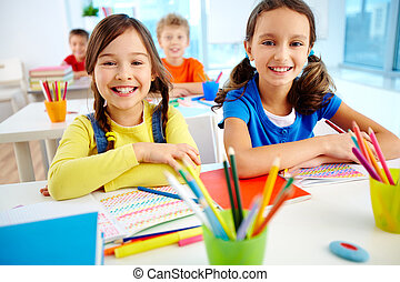 Youthful learners - Portrait of two diligent girls looking ...