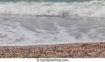 Youthful legs running along beach - Youthful legs running...