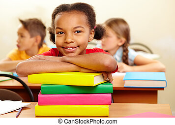 Youthful reader - Portrait of lovely girl with stack of ...