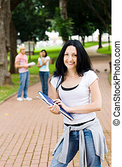youthful student - student standing posing in the park in...