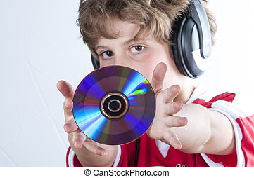 Youtuber, Blonde boy with music helmet on his head and musical records or cds in his hands