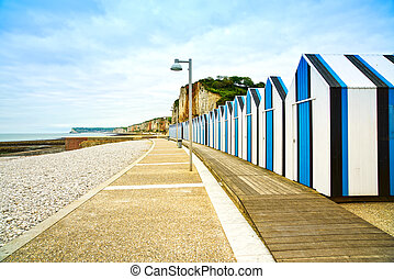 Yport and Fecamp, Normandy. Beach huts or cabins and cliffs in low tide ocean. France, Europe.