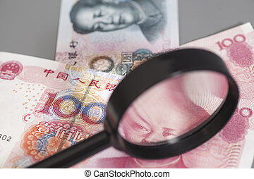 Yuan chinese money with magnifier glass