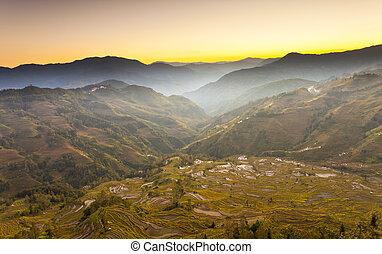 Yuanyang rice terraces sunset in Yunnan, China.