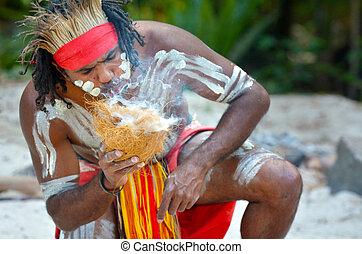 Yugambeh Aboriginal warrior man demonstrate fire making...
