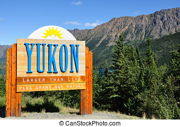 Yukon Territory, Canada Welcome Sign with Mountains in the...