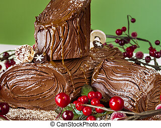 Traditional Christmas Yule Log cake decorated with marzipan mushrooms.